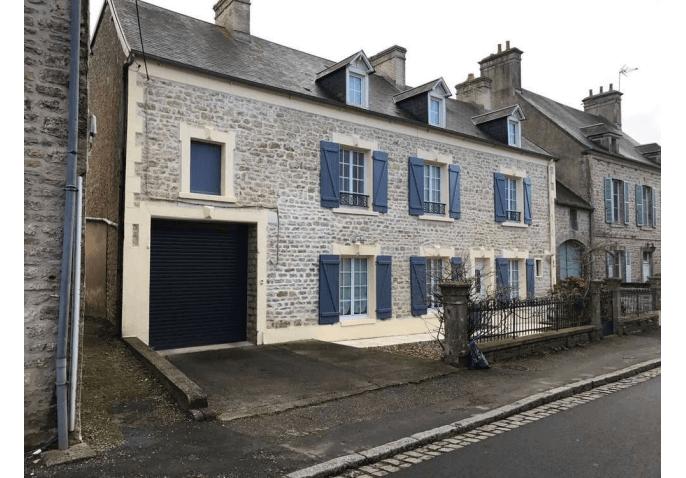 Chantier porte de garage enroulable en aluminium à Cherbourg